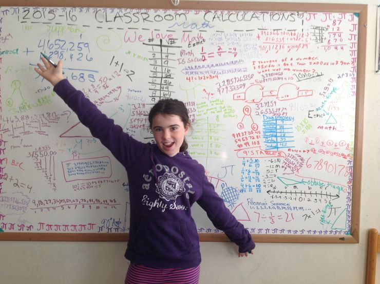 student in front of white board